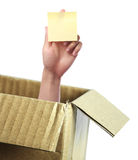 Hand with blank sticky note out of box Royalty Free Stock Photo