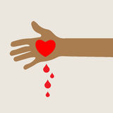 Hand with bleeding love heart Stock Photos