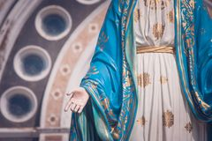 The Blessed Virgin Mary statue standing in front of The Cathedral of the Immaculate Conception at The Roman Catholic Diocese. royalty free stock image