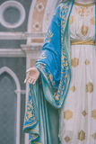 Hand of The Blessed Virgin Mary statue standing in front of The Roman Catholic Diocese that is public place. Stock Photos