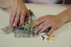 Hand with  blisters of pills. Human hand holding  blisters with medicals Royalty Free Stock Image