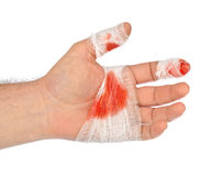 Hand with blood and bandage. Isolated on white background Royalty Free Stock Photography