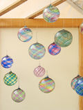 Hand-blow glass ornaments. In an art's festival booth Royalty Free Stock Photo