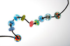 Hand Blown Glass Beads. Handblown lampwork glass beads on a black cord Royalty Free Stock Photos