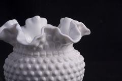 Hand blown white vase. A piece of white hand blown glass. Fenton glass, now closed and out of business, is a prized collectable. Especially older pieces such as royalty free stock images