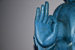 Hand of the blue Buddha Royalty Free Stock Photo
