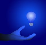 Hand and blue bulbs Royalty Free Stock Photography