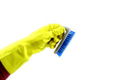 Hand with blue cleaning brush Royalty Free Stock Image