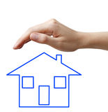 Hand with blue concept house Stock Photos