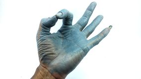 Hand in blue enamel color. On white and blue background royalty free stock photography
