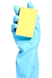 Hand in blue glove with sponge Stock Image