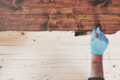 Hand In Blue Gloves Painting Wooden Furniture In Motion Blur Sty Stock Photo