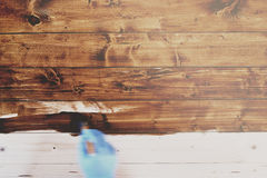 Hand In Blue Gloves Painting Wooden Furniture In Motion Blur Sty Royalty Free Stock Images