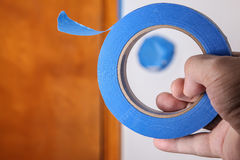 Hand with blue masking tape royalty free stock photo