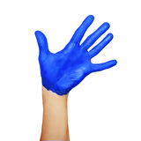 Hand in blue paint Stock Image