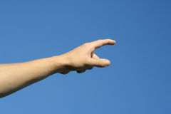 Hand and blue sky. The hand on the blue sky Royalty Free Stock Images