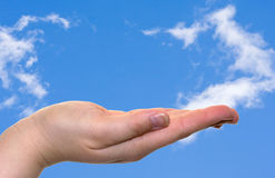 Hand and blue sky Royalty Free Stock Photo