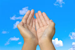 Hand in blue sky Royalty Free Stock Photography