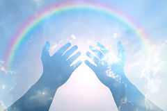 Hand on Blue sky with rainbow Stock Photography