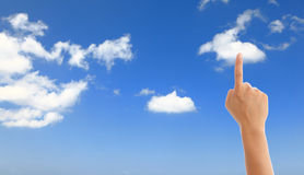 Hand with blue sky and white cloud Stock Image
