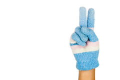 Hand in blue winter glove gesture number two against white backg Stock Photo