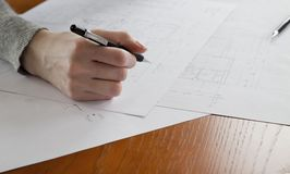 Hand and blueprint Royalty Free Stock Photo