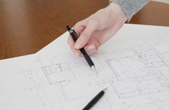 Hand and blueprint Royalty Free Stock Photography