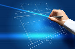 Hand and blueprint Stock Photos