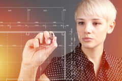 Hand and blueprint - engineer working on blue print Stock Images