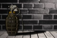 Hand bomb on wooden floor with background wall Stock Photography