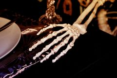 Hand bone on tableware,Halloween day.  royalty free stock photo