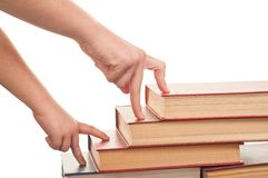 Hand and book Stock Photo