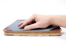 Hand on book Stock Images