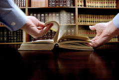 Hand on Book Stock Image
