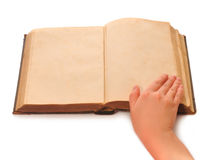Hand and the book. Female hand which thumbs through pages of the old book Royalty Free Stock Photos