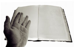 Hand book  blank pages. Hand showing blank pages in old book. isolated on white.could be bible or other ancient text Stock Photo