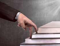 Hand and book stairs Stock Photo