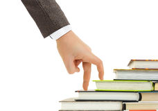 Hand and book stairs Stock Photos
