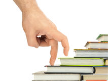 Hand and book stairs Royalty Free Stock Photography