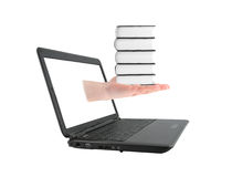 Hand with books and laptop Stock Images