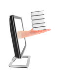 Hand with books and lcd monitor Royalty Free Stock Image