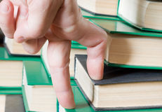 Hand on the books. Royalty Free Stock Image