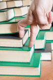 Hand on the books. Royalty Free Stock Images