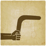 Hand with boomerang old background Stock Images