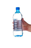 Hand with bottle of clear water Stock Photos