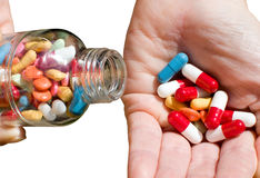 Hand bottle with drug and pills Royalty Free Stock Photos