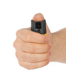 Hand with bottle of pepper spray Stock Images