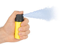 Hand with bottle of pepper spray Royalty Free Stock Photography