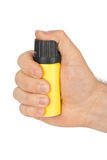Hand with bottle of pepper spray Stock Image