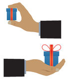 Hand with a box (with a gift). Royalty Free Stock Image